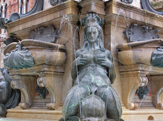 Erotic metal sculptures of mermaids on the Neptune Fountain in Bologna.
