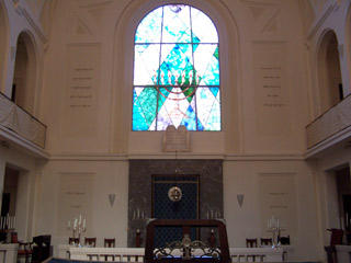 Stained glass window above the altar in the Synagogue of Bologna.