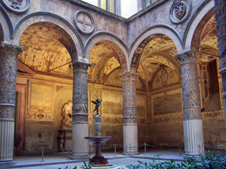 "Palazzo Vecchio courtyard with copy of ""Winged Boy with a Dolphin""."