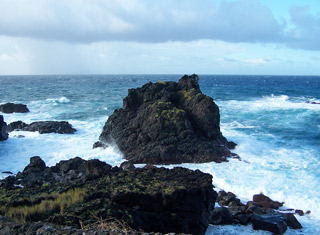 waves smashing against the rocky lava coastline